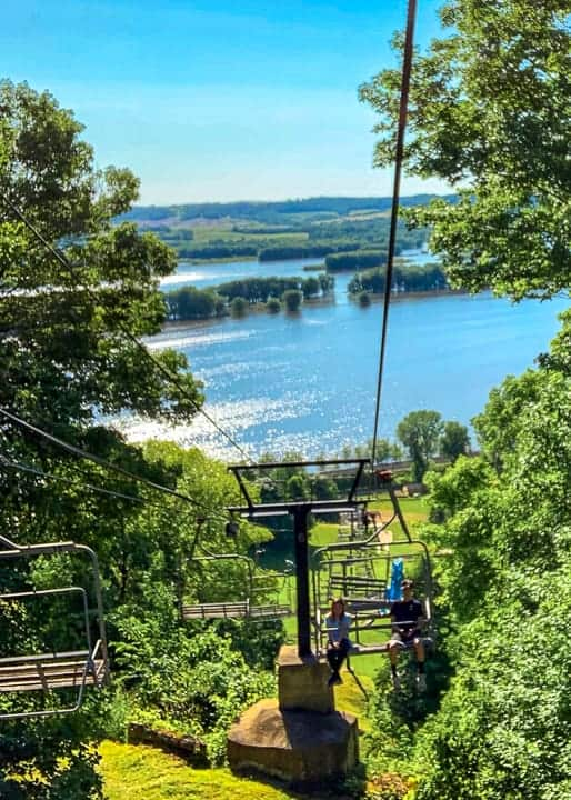 things to do in galena il showcasing the view from the ski lift at chestnut mountain in the summer