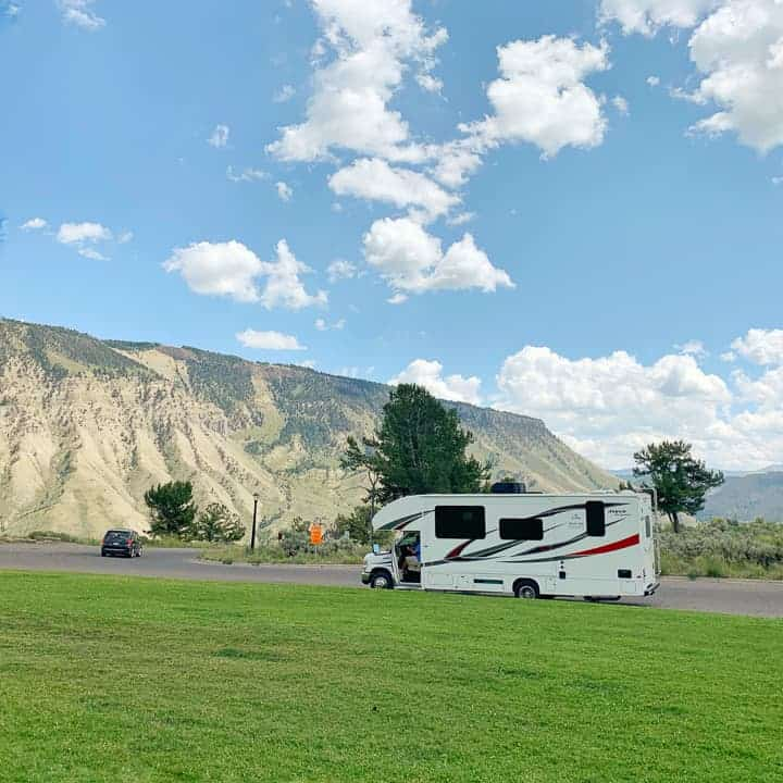 A view of a rental rv in front of mountains in Mammoth hot spring in Yellowstone national parl.