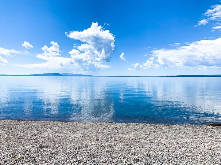Yellowstone lake with the reflection of the sky in the water.