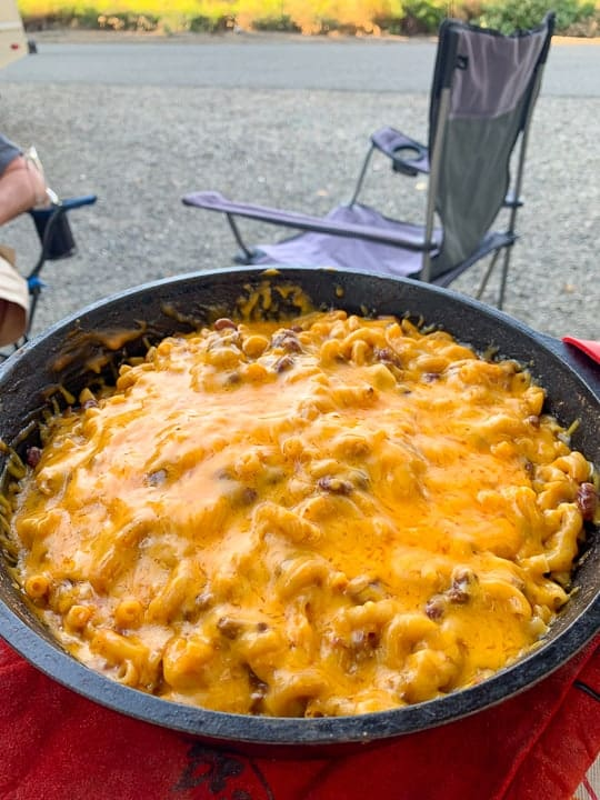 skillet of chili Mac being made in a campground