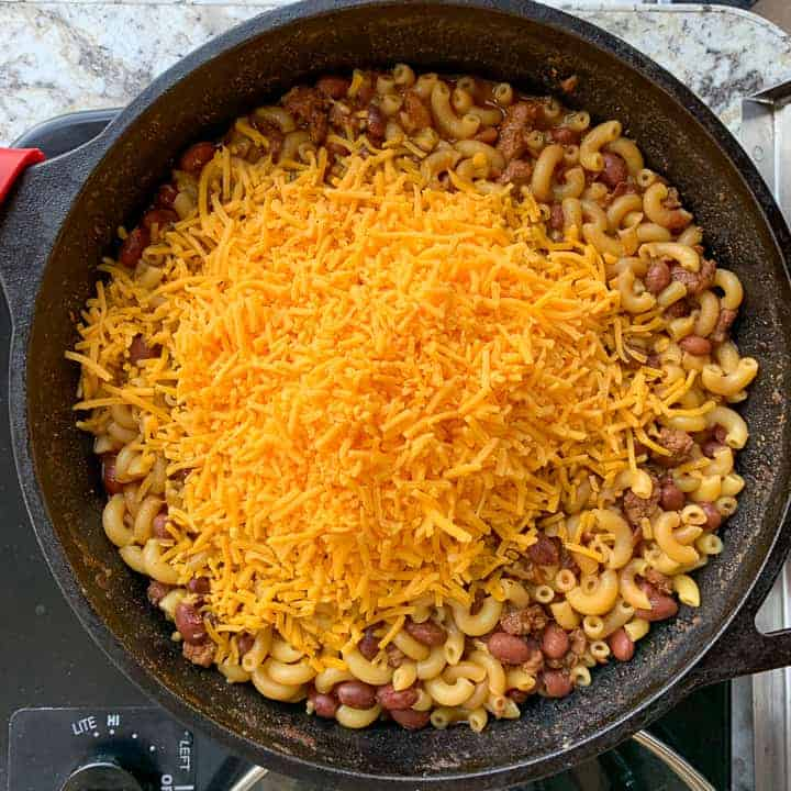 skillet of chili Mac being make in a campground