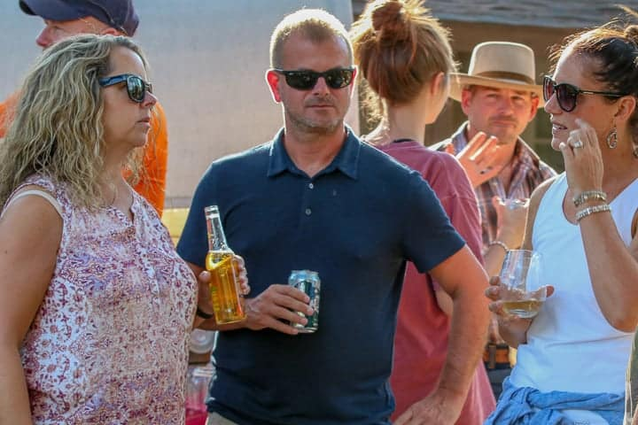 Ranch visitors enjoying social hour and sharing memories of their days on the dude ranch Colorado.