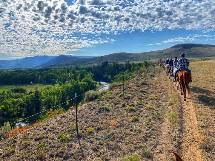 family ranch vacation, the whole ranch being shown heading out together for a scenic ride to their Breakfast Site that sits along the Colorado River.