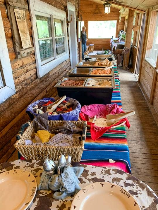 A buffet of food being shown on a Colorado ranch before the bell rings to let ranchers know the meal is served.