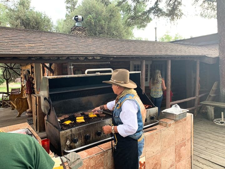Bar Lazy's owner, Cheri, cooking burgers, salmon, steak on the outdoor grill at the Colorado ranch.