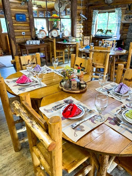 The all-inclusive dining experience at the family dude ranch being shown before ranchers travel into the cabin to enjoy a home cooked meal.
