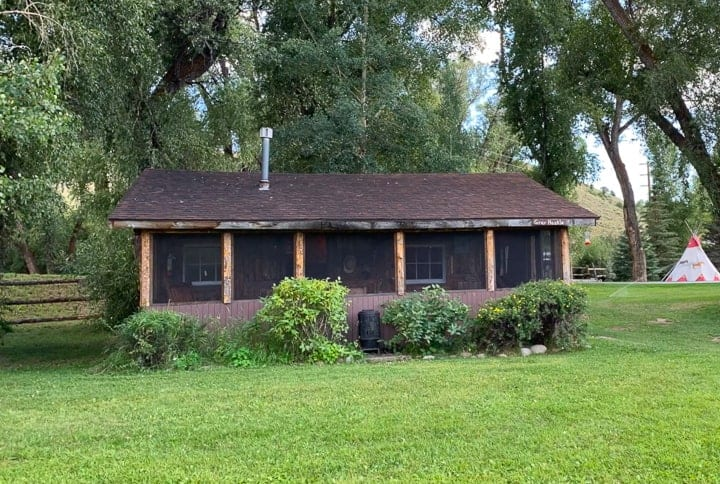 Grey Hackle, a two bedroom, two bathroom cabin being shown at a family dude ranch in Colorado.