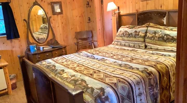 A bedroom in a log cabin at a family dude ranch in Colorado.