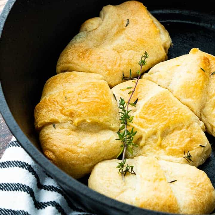 Chicken Pot Pie with Crescent Rolls, a crescent roll chicken pot pie recipe, showing baked pot pies in a cast iron skillet.