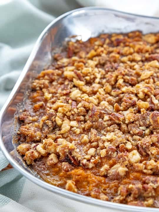 Sweet Potato Crunch, a sweet potato casserole with canned yams, showing the recipe baked in a dish on a countertop.