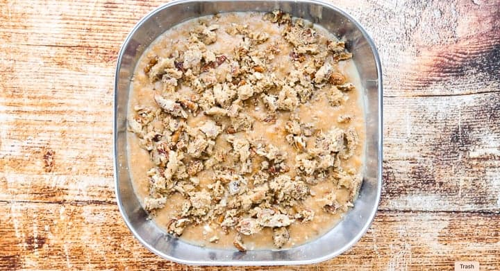 Sweet Potato Crunch, a sweet potato casserole with canned yams, showing the wet and dry ingredients combined in a baking dish on a countertop.