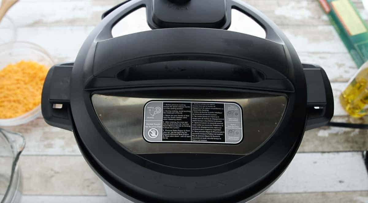 The Instant Pot lid being shown in How to Use An Instant Pot post.