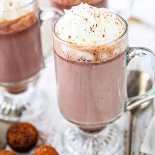 A cup of hot chocolate  on a table