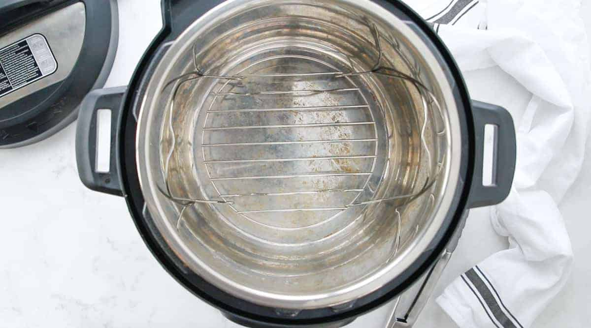 an empty instant pot with wire rack at the bottom of the pot.