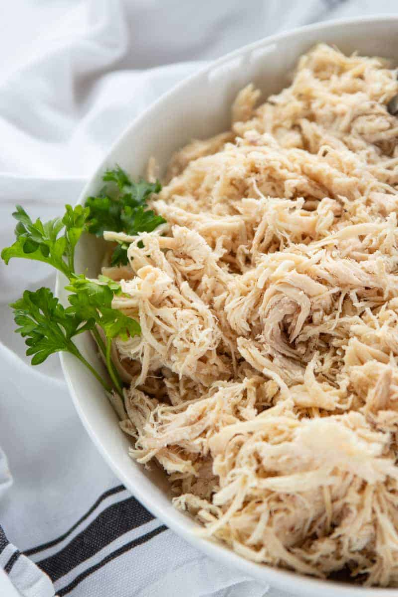 shredded chicken in a white serving bowl.
