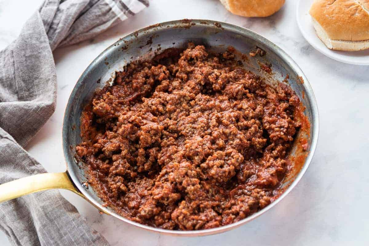 cooked sloppy Joe meat in a skillet with the mix stirred into the meat.