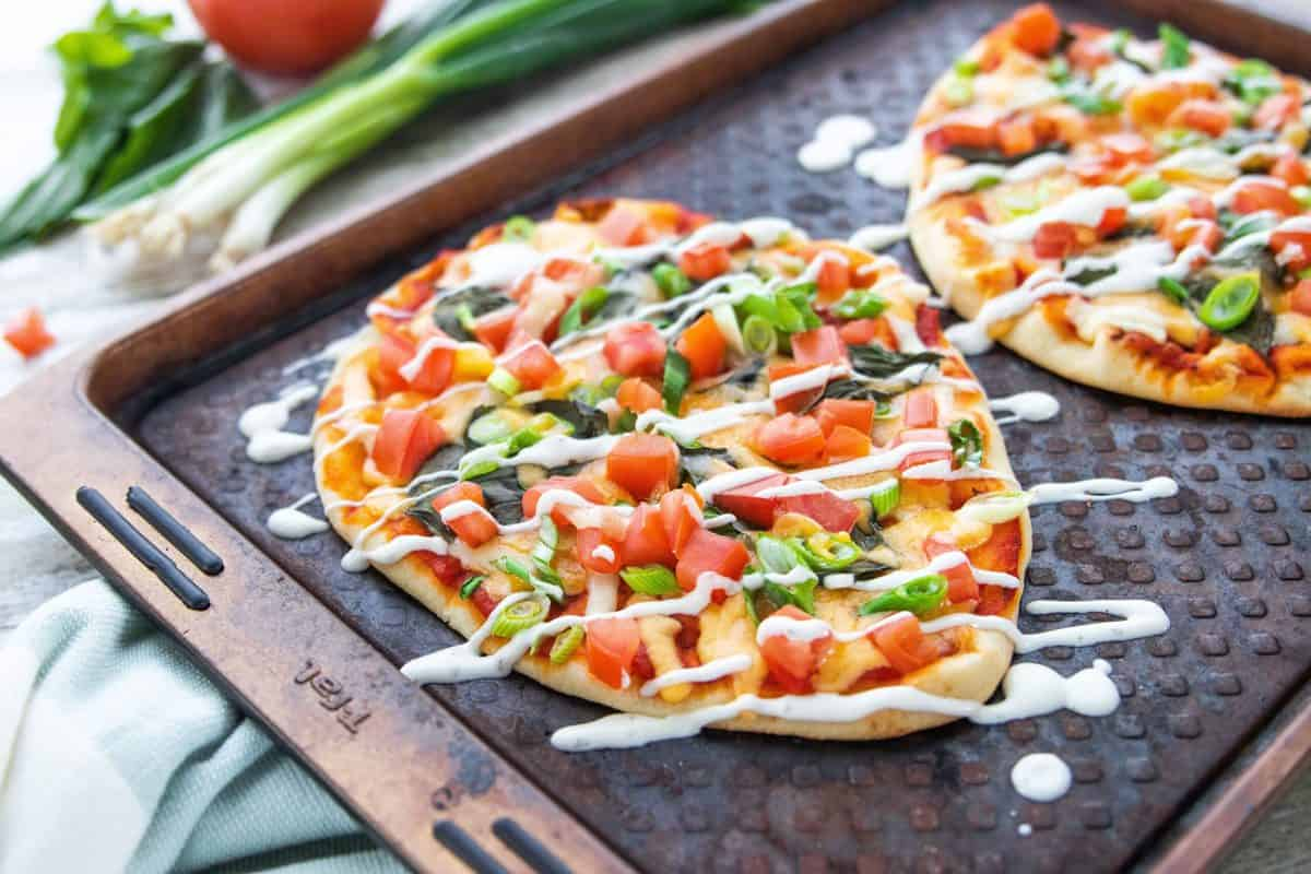 5 Veggie Packed Kid-Friendly Recipes showing a Naan pizza on a baking sheet.