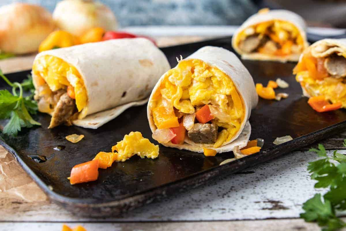 5 Veggie Packed Kid-Friendly Recipes showing Breakfast Burritos on a serving platter.