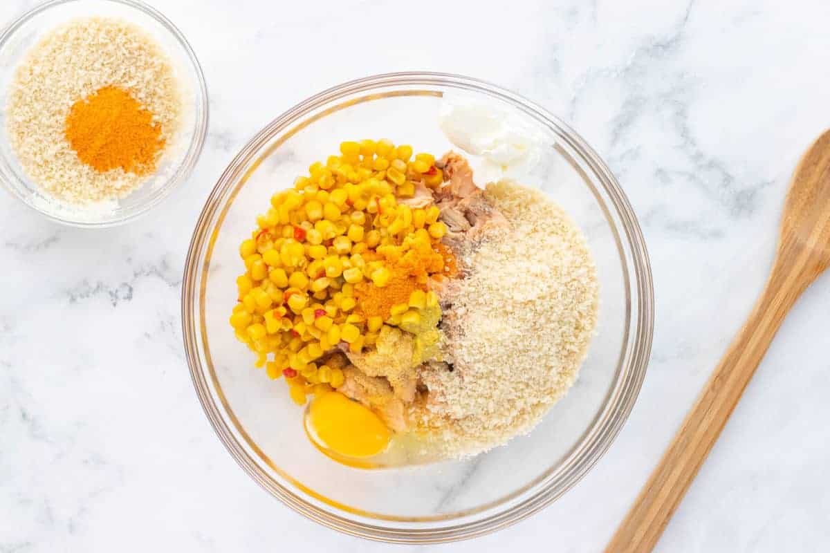 a bowl with corn, breadcrumbs, and other ingredients