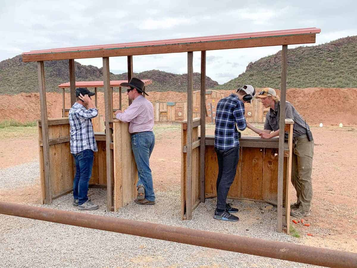White Stallion Ranch, the Best All-Inclusive Resort in Arizona showing trained professionals teaching a father and son in the shooting range.