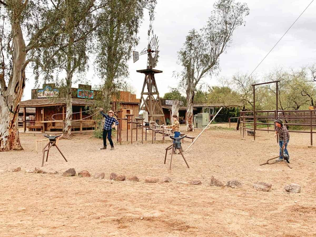 White Stallion Ranch, the Best All-Inclusive Resort in Arizona showing a family practicing their roping skills.