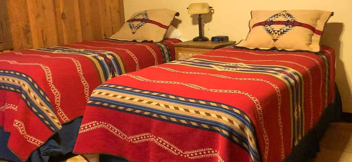White Stallion Ranch, the Best All-Inclusive Resort in Arizona showing inside of the guest room, which included two twin beds.