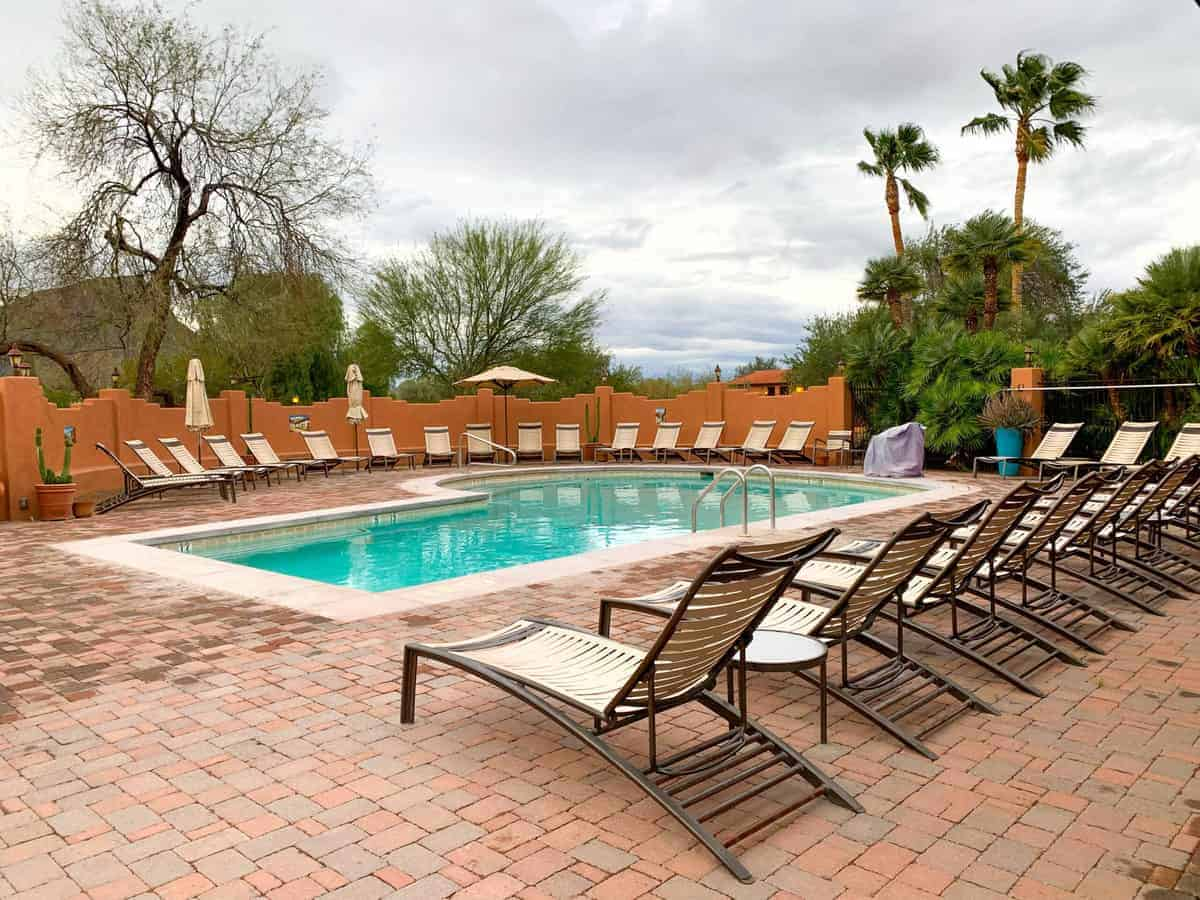 White Stallion Ranch, the Best All-Inclusive Resort in Arizona showing the heated pool with lounge chairs surrounding the pool area.