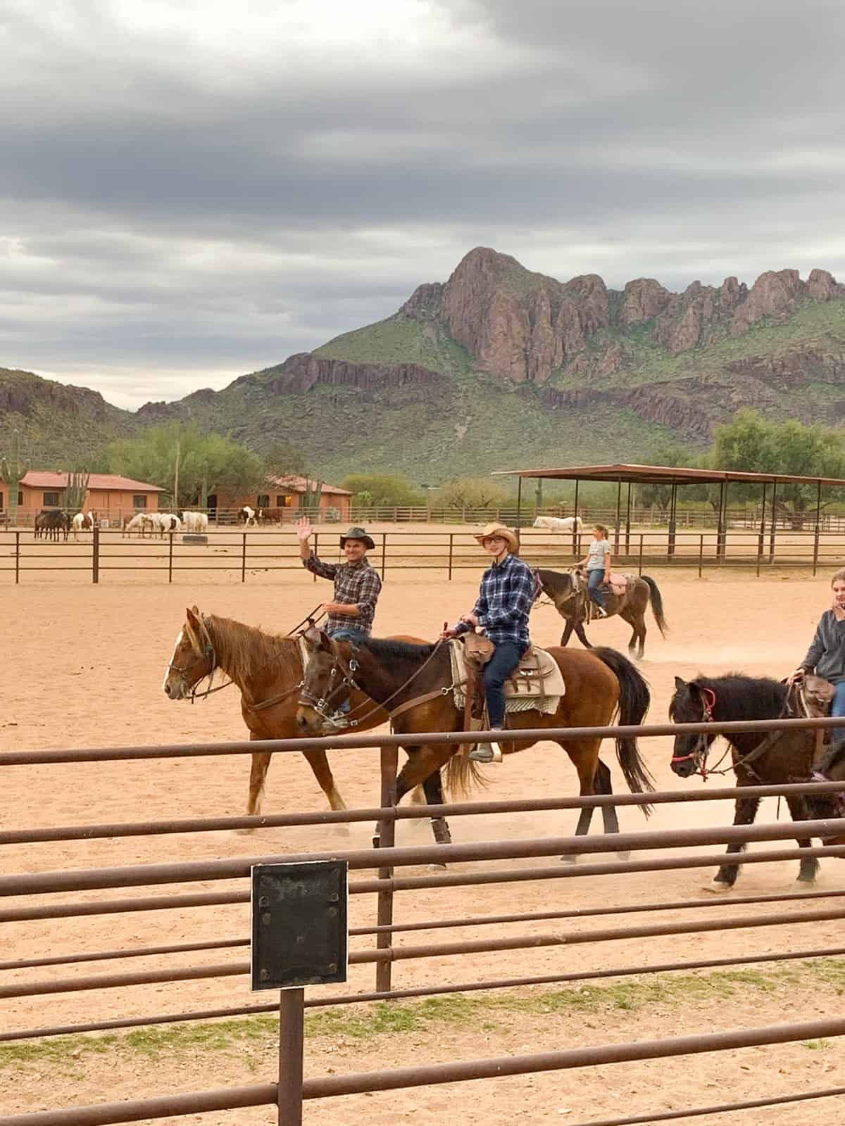 White Stallion Ranch, the Best All-Inclusive Resort in Arizona showing a family exploring the area on the ranch where Western movies were made.