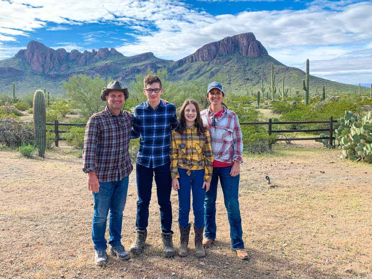 White Stallion Ranch, the Best All-Inclusive Resort in Arizona showing a family of four standing on the dude ranch.