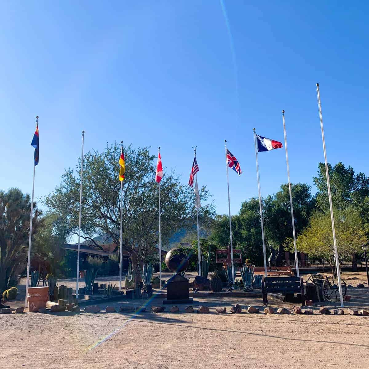 White Stallion Ranch, the Best All-Inclusive Resort in Arizona showing flags from different countries on the property of the dude ranch.