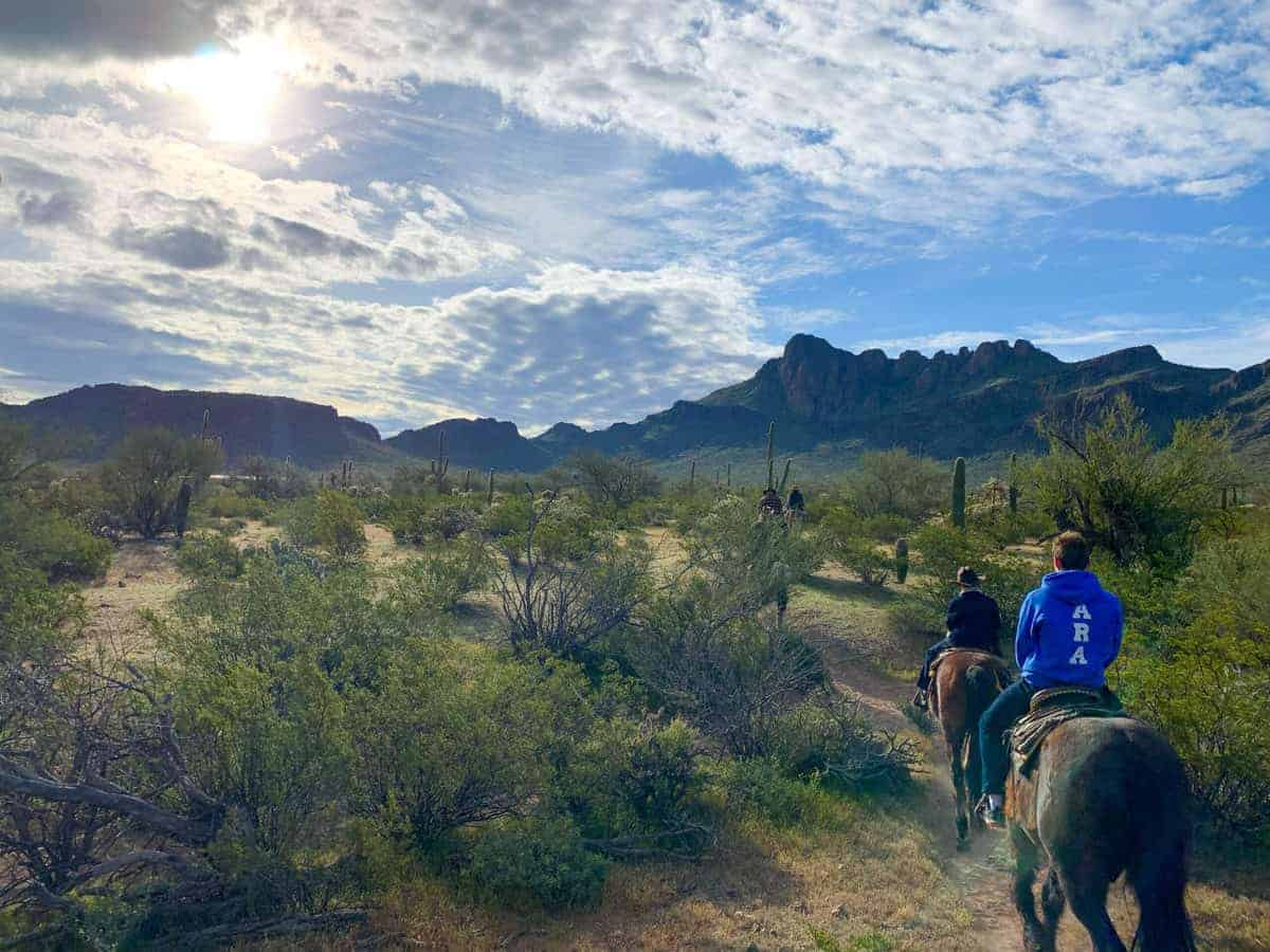 White Stallion Ranch, the Best All-Inclusive Resort in Arizona showing a family going on an afternoon ride with their horses.