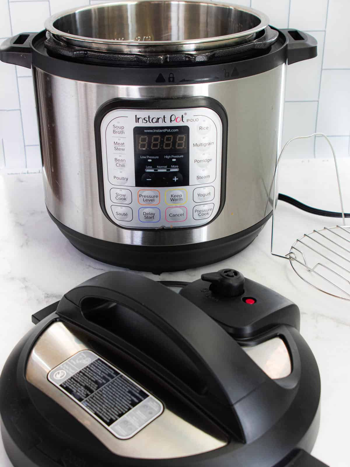 Instant pot shown on a white surface with the lid off.