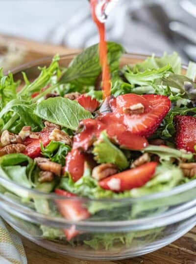 A bowl of salad, with Strawberries