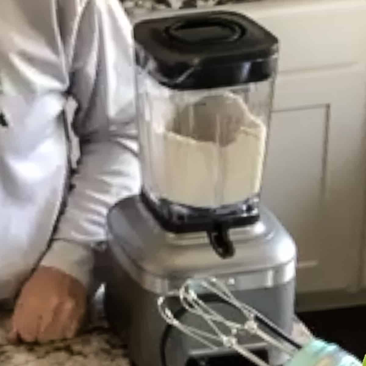 A blender with oatmeal pureed into a flour.