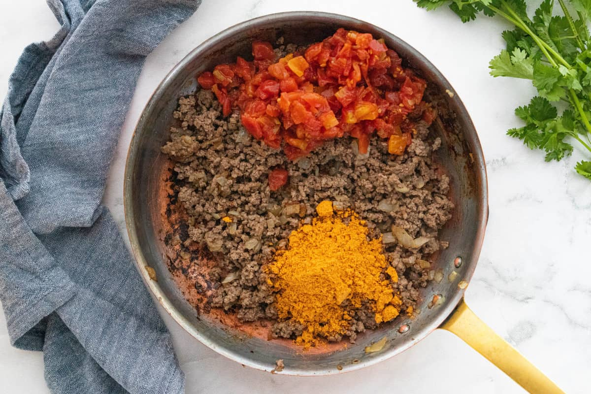 A bowl of food, with Ground beef