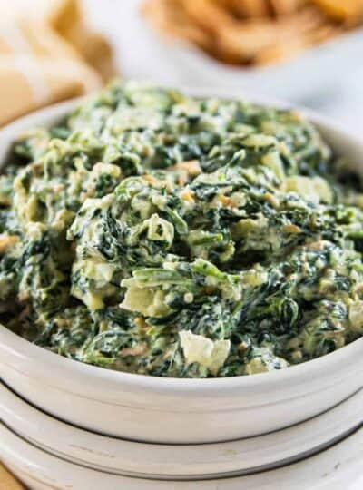 A bowl of dip with spinach