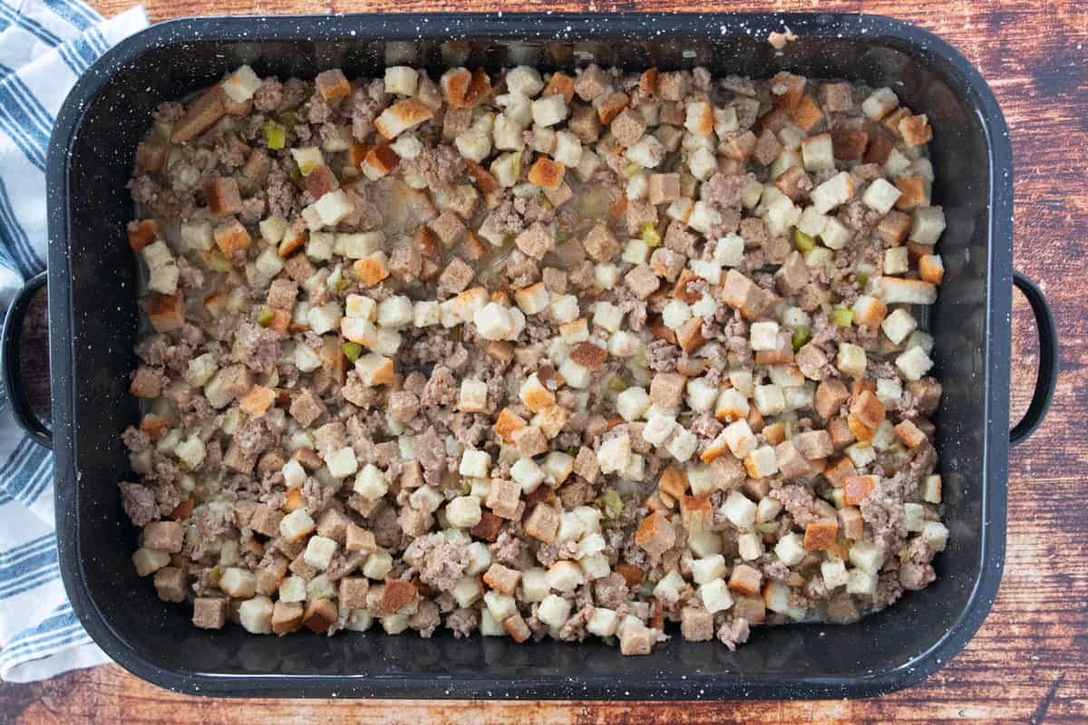 The ingredients for sage dressing being shown in a large roasting pan.