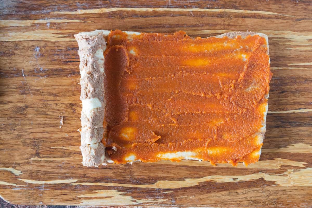 Canned pumpkin puree spread onto refrigerated cinnamon rolls.