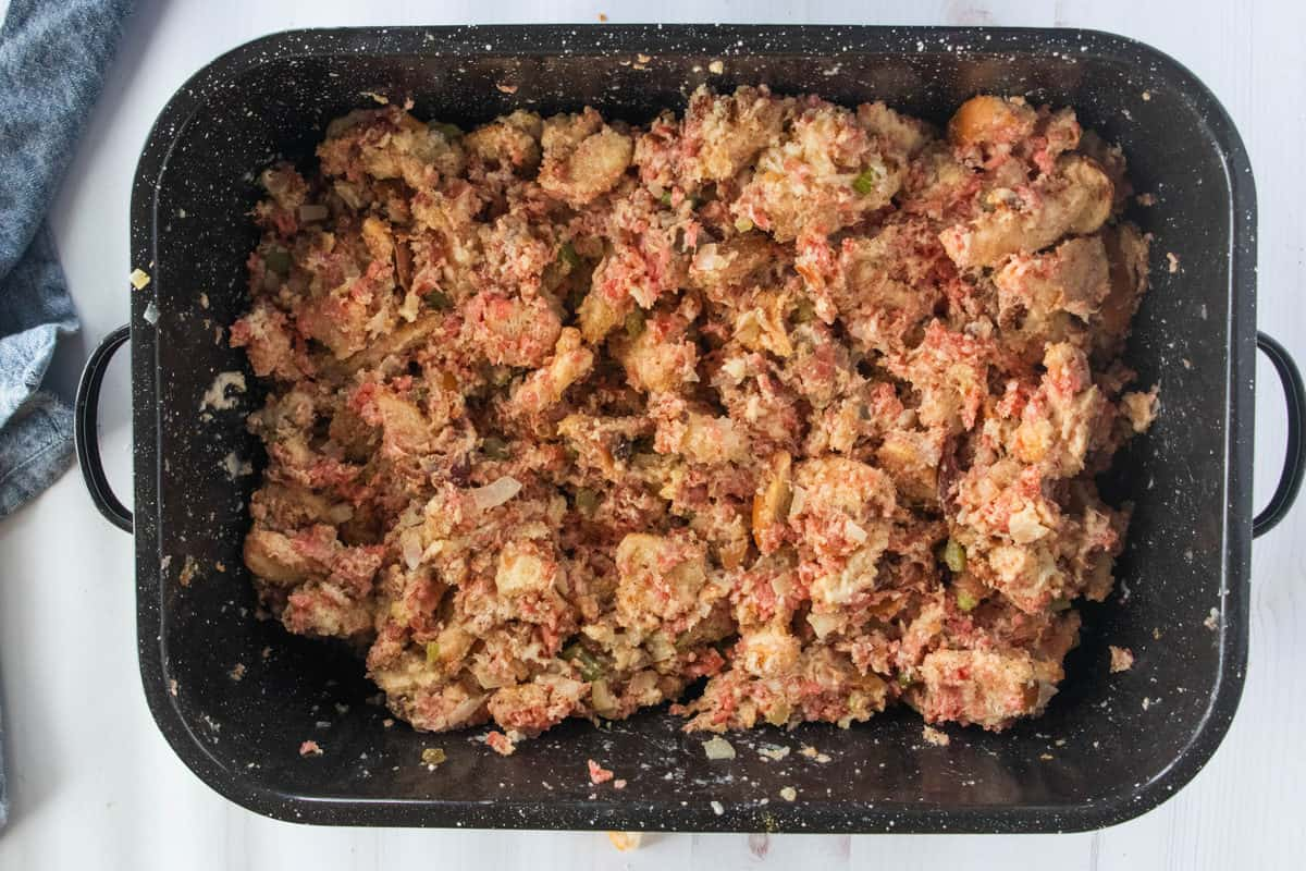 Ingredients for make-ahead stuffing mixed together in a large baking pan.