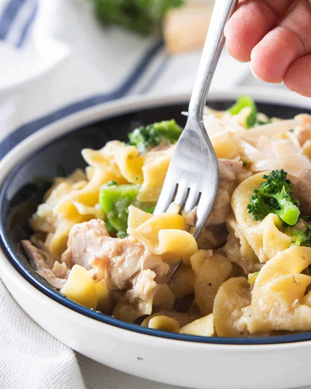 Chicken casserole in a bowl with a fork.