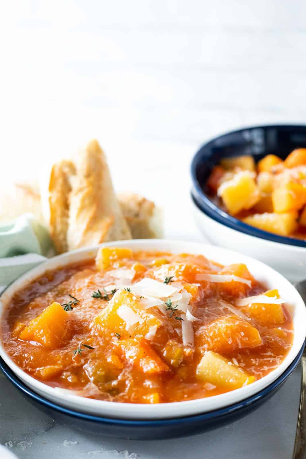 Slow cooker chunky vegetable soup in a serving bowl.