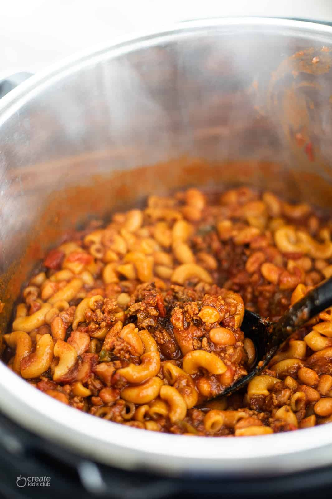 chili mac being scooped from the instant pot