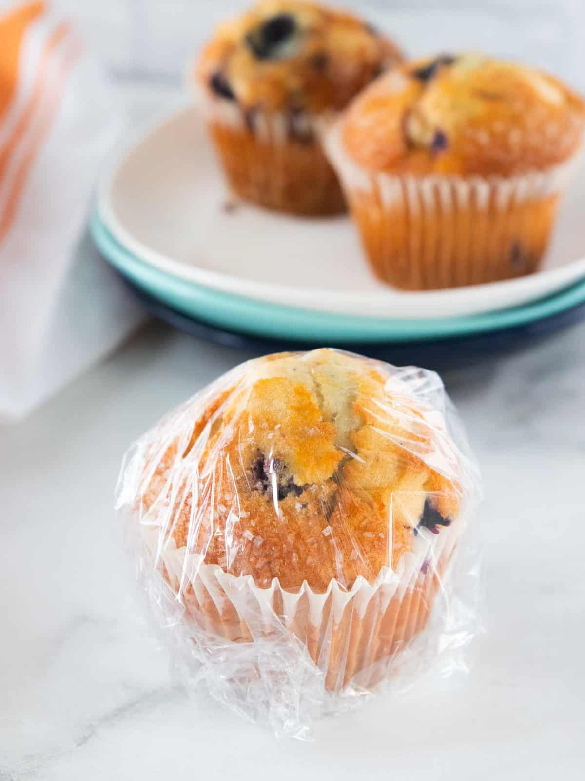 Muffin wrapped in Saran Wrap.