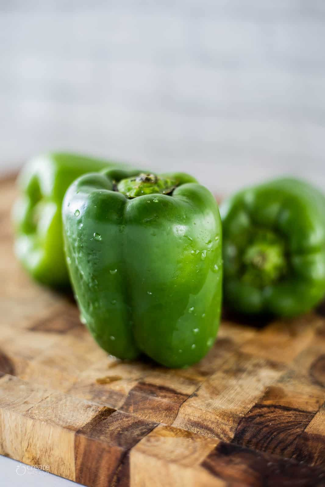 green bell peppers on cutting board
