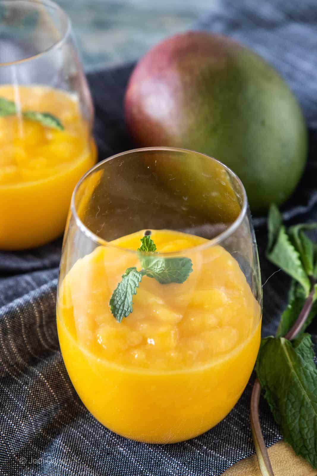 mango slushie in drinking glasses