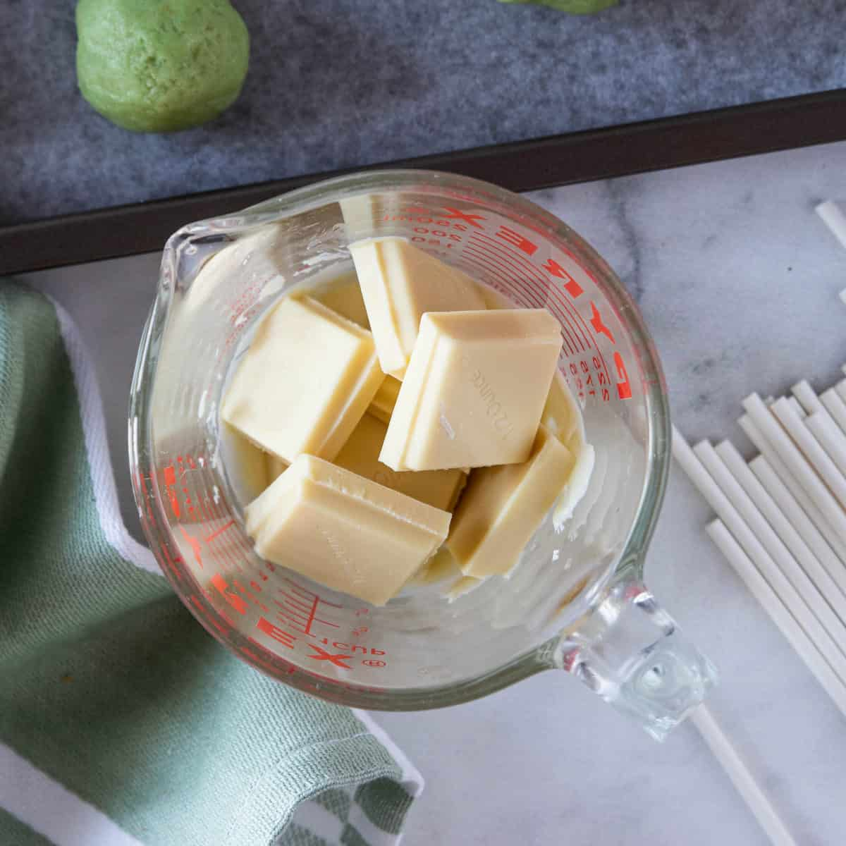 white chocolate pieces in a measuring cup