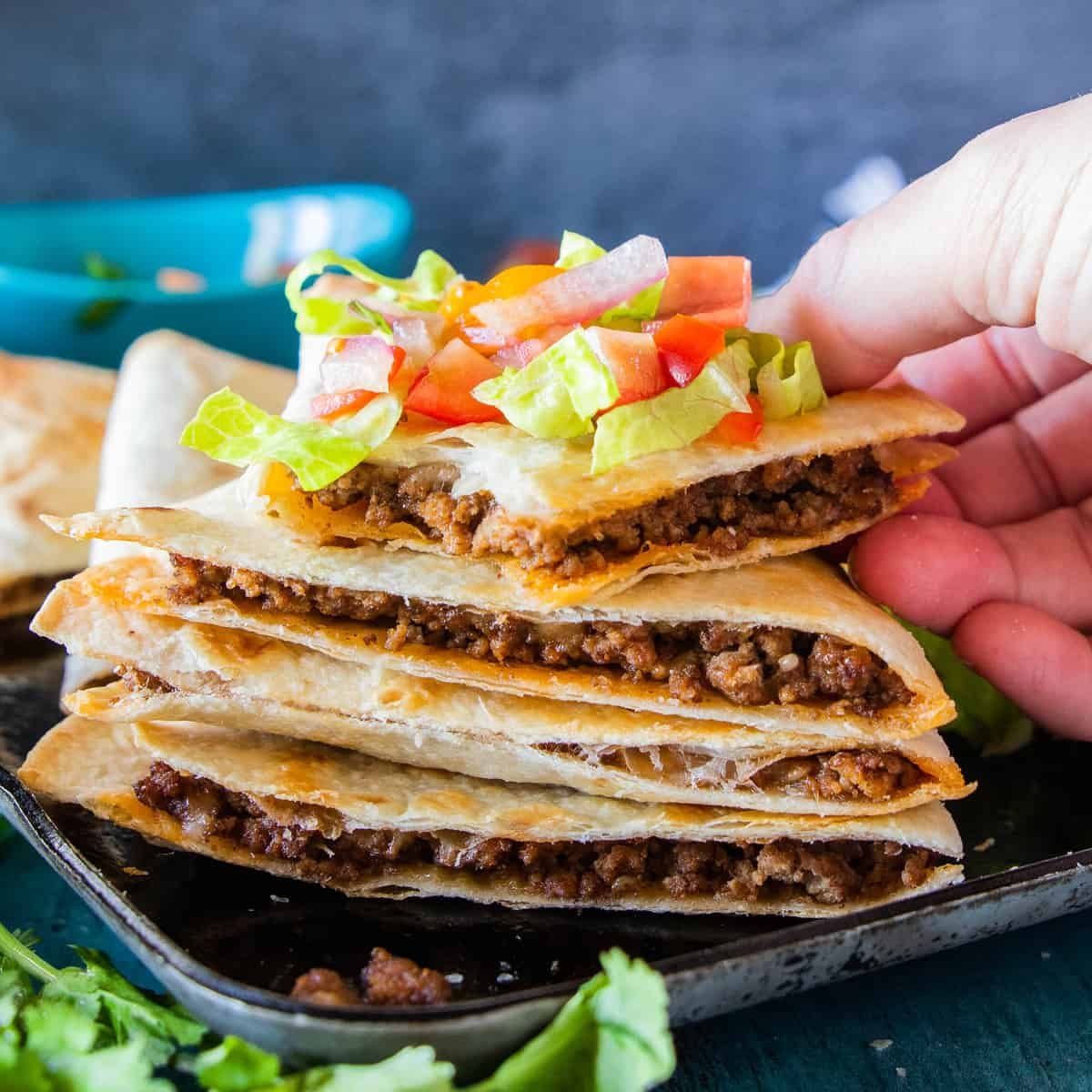 quesadillas sliced and stacked with premade salsa on top