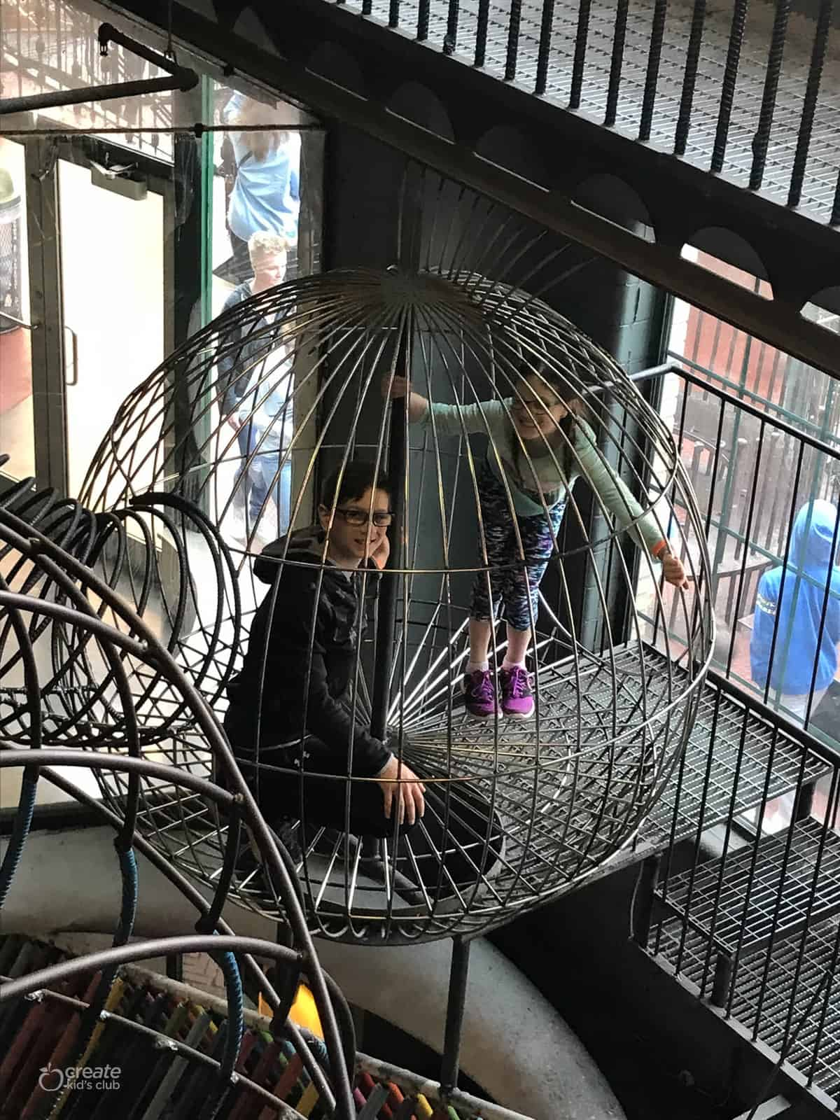 kids climbing in the St. Louis City Museum