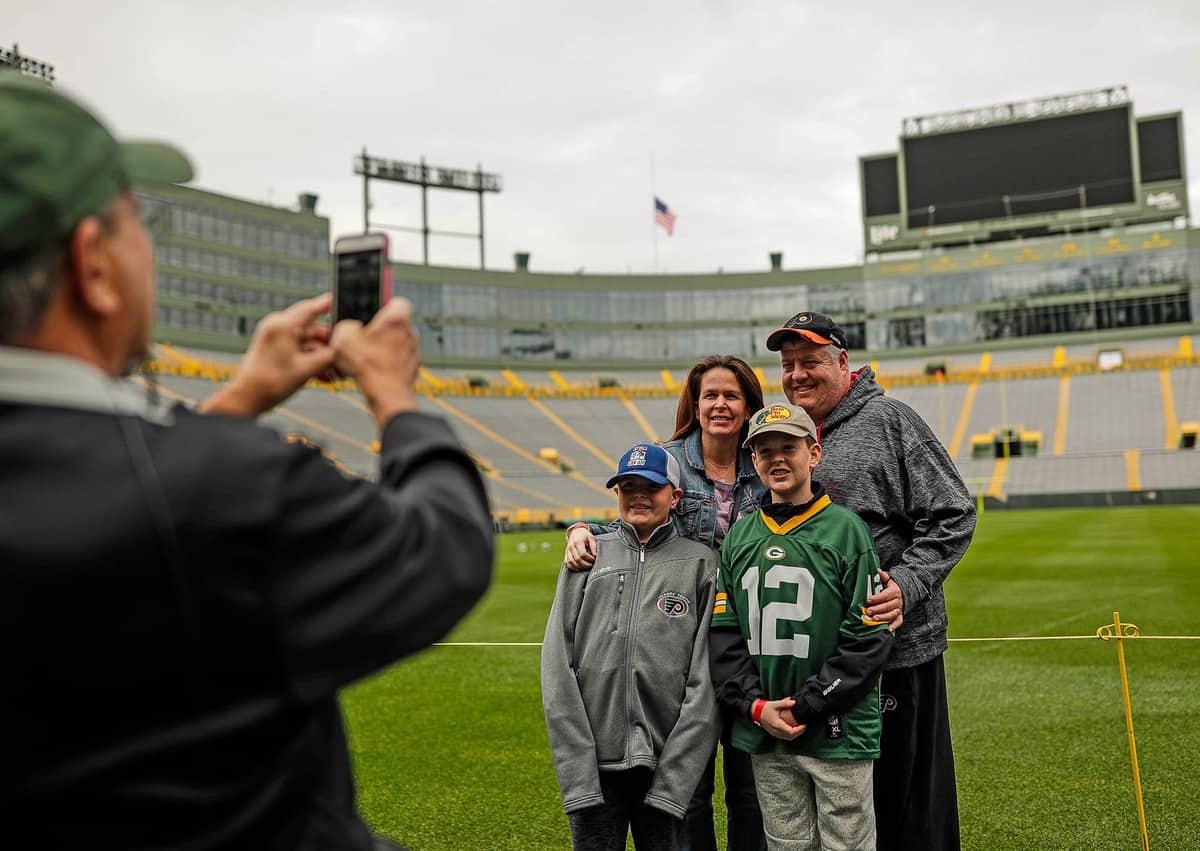 family taking a photo at Lambeau Field Stadium