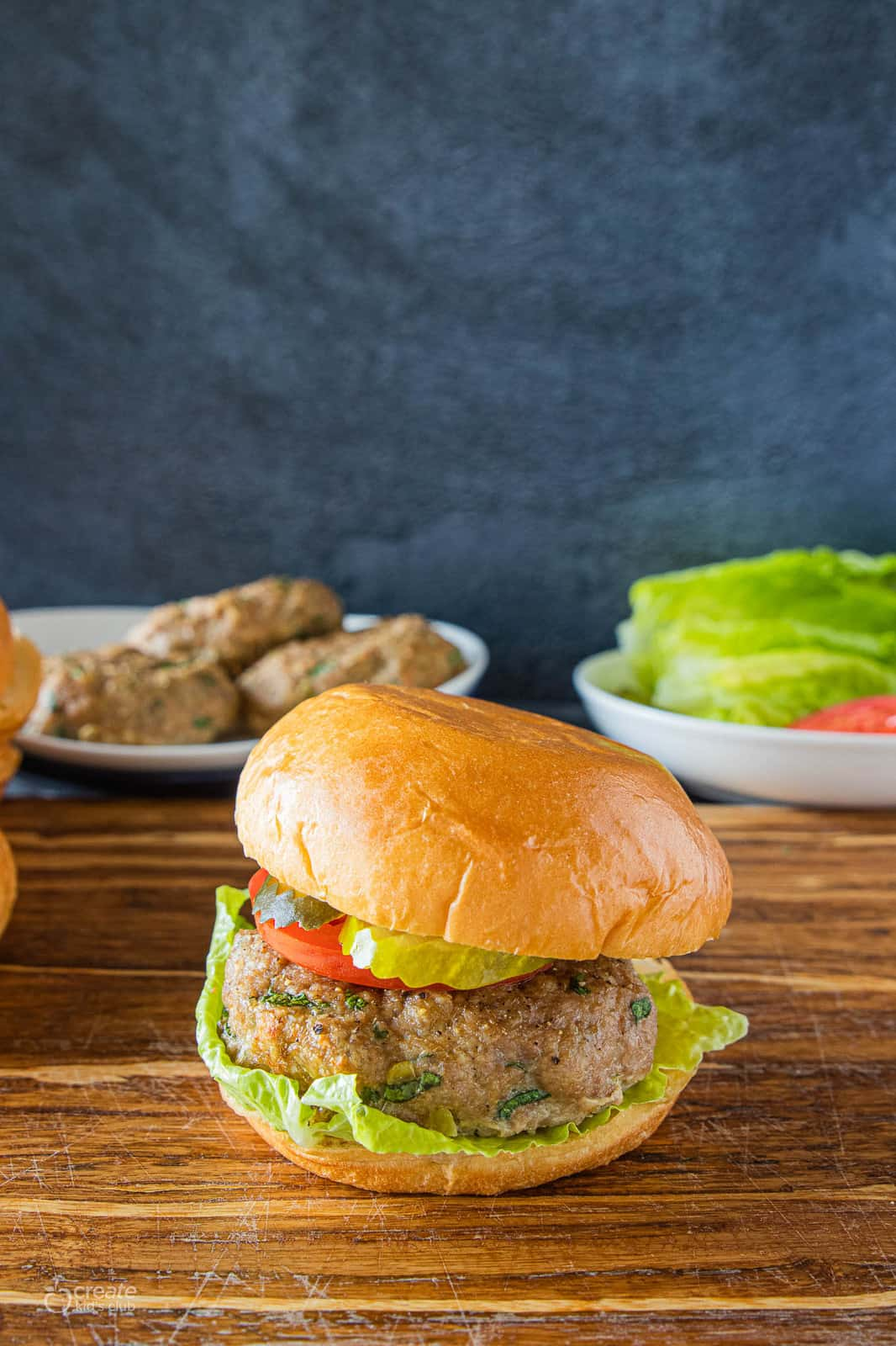 turkey burger with a bun and burger toppings